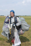 Skydiver after landing. Stock Photos