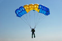 Skydiver on parachute Royalty Free Stock Image