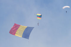 Skydiver with Romanian Flag through clouds Stock Photo