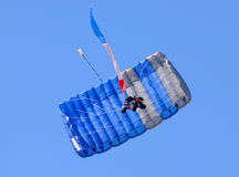 Skydiver seen from below Stock Photo