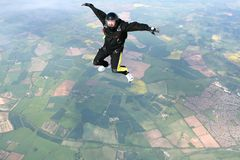 Skydiver in a sit position. While in freefall Royalty Free Stock Image