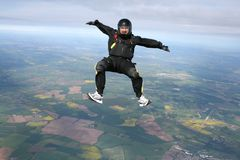 Skydiver in a sit position. While in freefall Stock Image