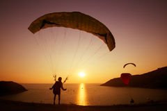 Skydiver skydiving group sunset concept stock images