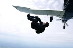 Skydiver tumbles out of an airplane. High up in the air Stock Image
