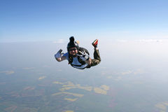 Skydiver waves at the cameraman. While in freefall Royalty Free Stock Photography