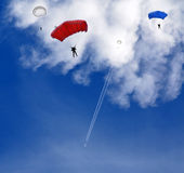 Skydivers and blue sky Stock Photography