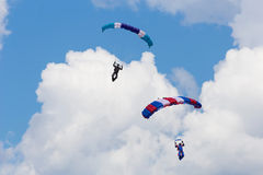 Skydivers among the clouds and blue sky Stock Photography