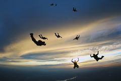 Skydivers are falling in the storm sky. royalty free stock image