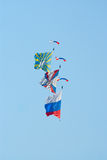 Skydivers with flags Royalty Free Stock Photos