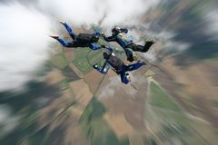 Skydivers in freefall. Three skydivers in freefall performaing formations Stock Photo
