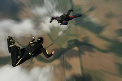 Skydivers in freefall. Two skydivers is freefall doing formations Royalty Free Stock Photography