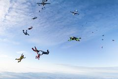 Skydivers have jumped out of two airplanes. royalty free stock image
