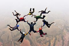 Free Skydivers Holding Hands Making A Fomation. High Angle View. Royalty Free Stock Image - 213568516
