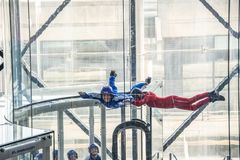 Skydivers in indoor wind tunnel, free fall simulator in Paris. France royalty free stock images
