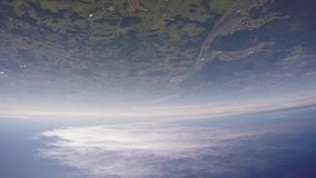 Skydivers jump from airplane falling in sky. Over green land. Clouds. Extreme. Skydivers jump from airplane falling in sky. Over green land. Clouds. Extreme stock video footage