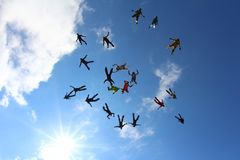Skydivers are moving from each other in the sky. royalty free stock photos