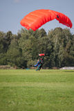 Skydivers parachutist on blue sky on sunset Royalty Free Stock Images
