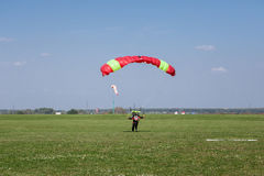 Skydivers parachutist on blue sky on sunset Royalty Free Stock Photo