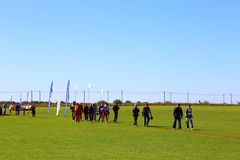 Skydivers ready to jump and go to the aircraft on the green grass stock photo