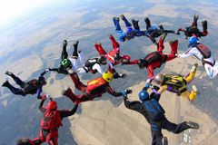 Skydivers are in the sky. stock photo