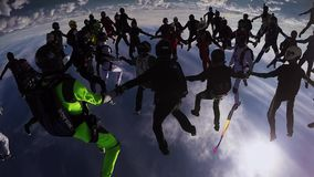 Skydivers team making big formation in sky. Height. Extreme stunt. Evening. Falling stock video