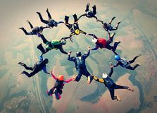 Skydivers team work photo effect stock images