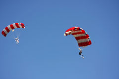 Skydiving. Sky divers landing with open parachute Royalty Free Stock Photo