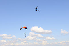 Skydiving above clouds. Royalty Free Stock Image
