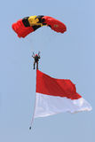 Skydiving attractions. Indonesian soldiers do skydiving attractions in a ceremony, Central Java, Indonesia Royalty Free Stock Photography