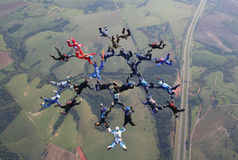 Skydiving big group formation. Teamwork. This is necessary to make a beautiful and perfect formation/figure in skydiving . Concentration, focus and determination Royalty Free Stock Photo