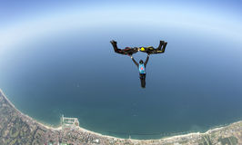 Skydiving 3D formation having fun over sea stock photo