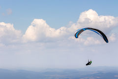 Skydiving  extreme over the mountains Stock Photography
