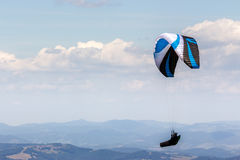 Skydiving  extreme over the mountains Stock Image