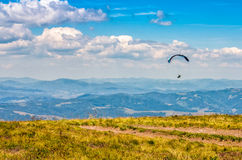 Skydiving extreme over the mountains. Skydivers fly over the mountains. Parachute extreme sport Royalty Free Stock Photos