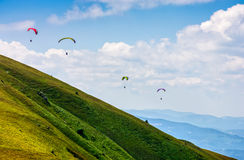 Skydiving extreme over the mountains. Skydivers fly over the mountains. Parachute extreme sport Stock Images