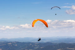 Skydiving  extreme over the mountains. Two persones skydiving  flying over the mountains. parachute extreme sport Royalty Free Stock Images