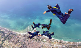Skydiving formation with videoman over sea Royalty Free Stock Photography