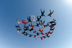 Skydiving group formation low angle view stock photo