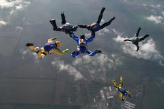 Skydiving group. In the sky. Teamwork of people Royalty Free Stock Photography