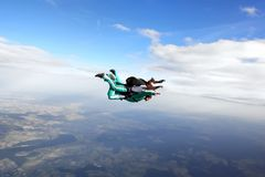 Tandem skydiving. Skydiving instructor and his client enjoying tandem skydiving Royalty Free Stock Photo