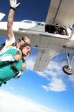 Tandem skydiving. Skydiving instructor and his client enjoying tandem skydiving Royalty Free Stock Photos