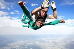 Tandem skydiving. Skydiving instructor and his client enjoying tandem skydiving Royalty Free Stock Image
