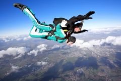 Tandem skydiving. Skydiving instructor and his client enjoying tandem skydiving Stock Image