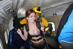 Skydiving. Nice girl is going to tandem jump. stock photography