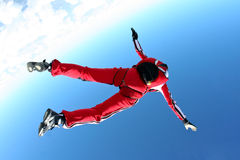 Skydiving photo. Parachutist falls back to earth stock image