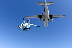 Skydiving photo. The athlete performs a free-fall parachutist royalty free stock image
