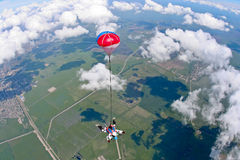 Skydiving photo. Tandem jump, free fall of two people stock photos