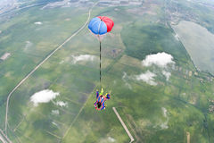Skydiving photo. Sports tandem jump, free fall under stabilization royalty free stock images