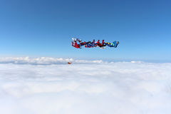 Skydiving photo. Several paratroopers do sports in a free fall jump stock images