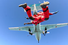 Skydiving photo. Several paratroopers do sports in a free fall jump stock photos